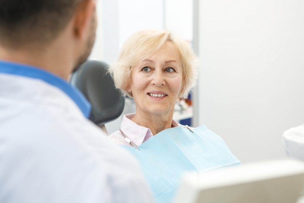 older woman sitting in a dentist chair